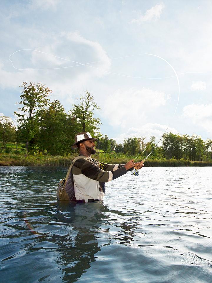 man fishing standing in water