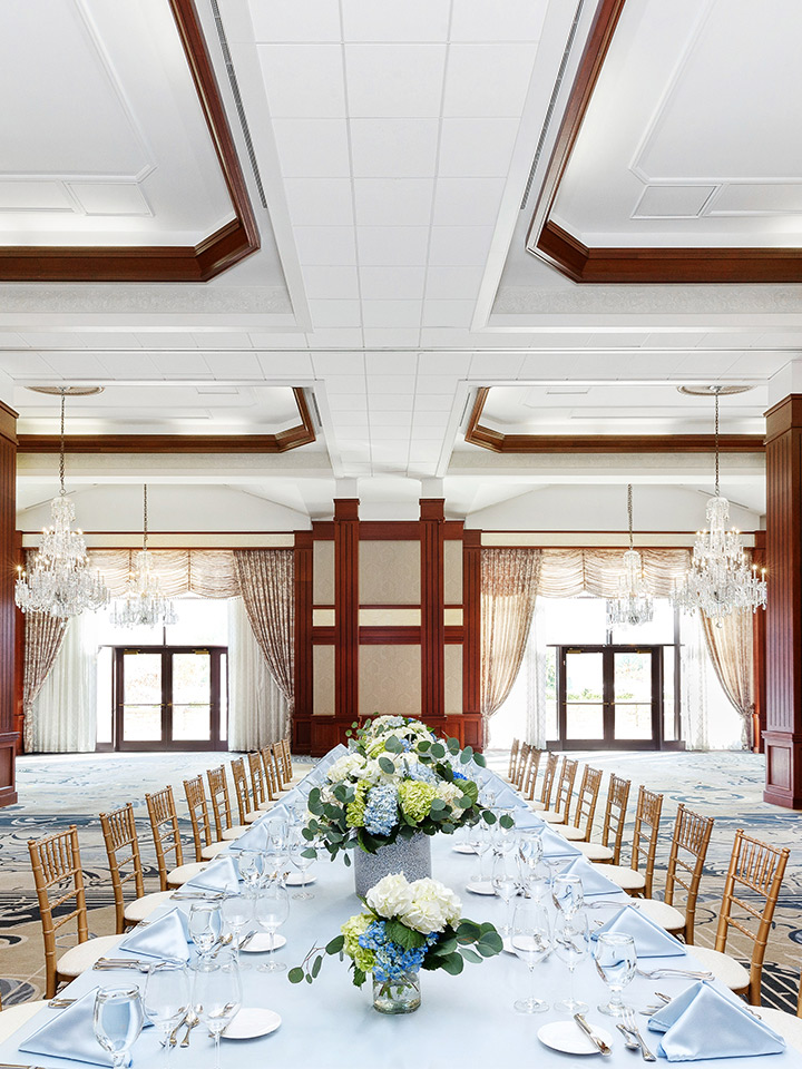 White room long set table with flowers