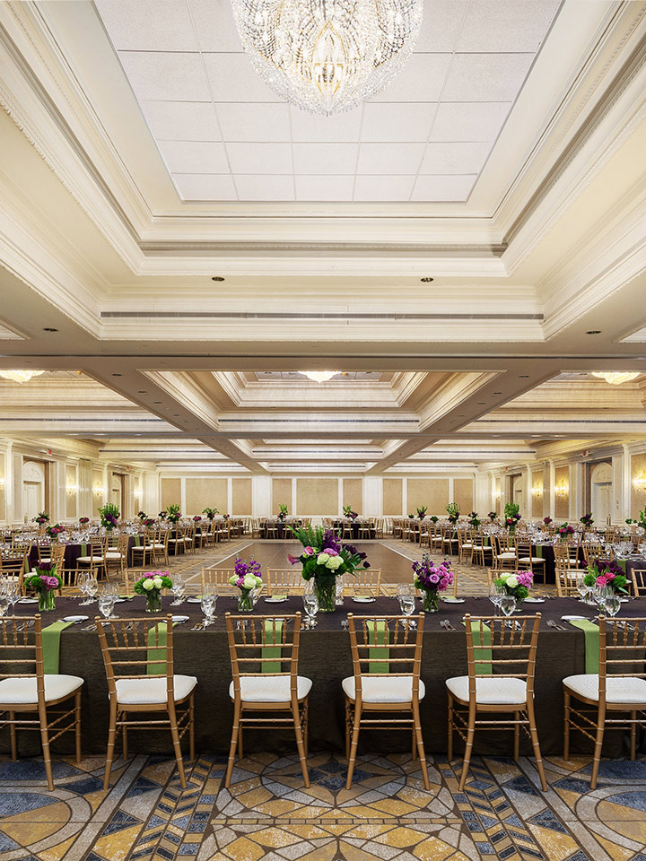 large square room with table and chairs surrounding the perimeter