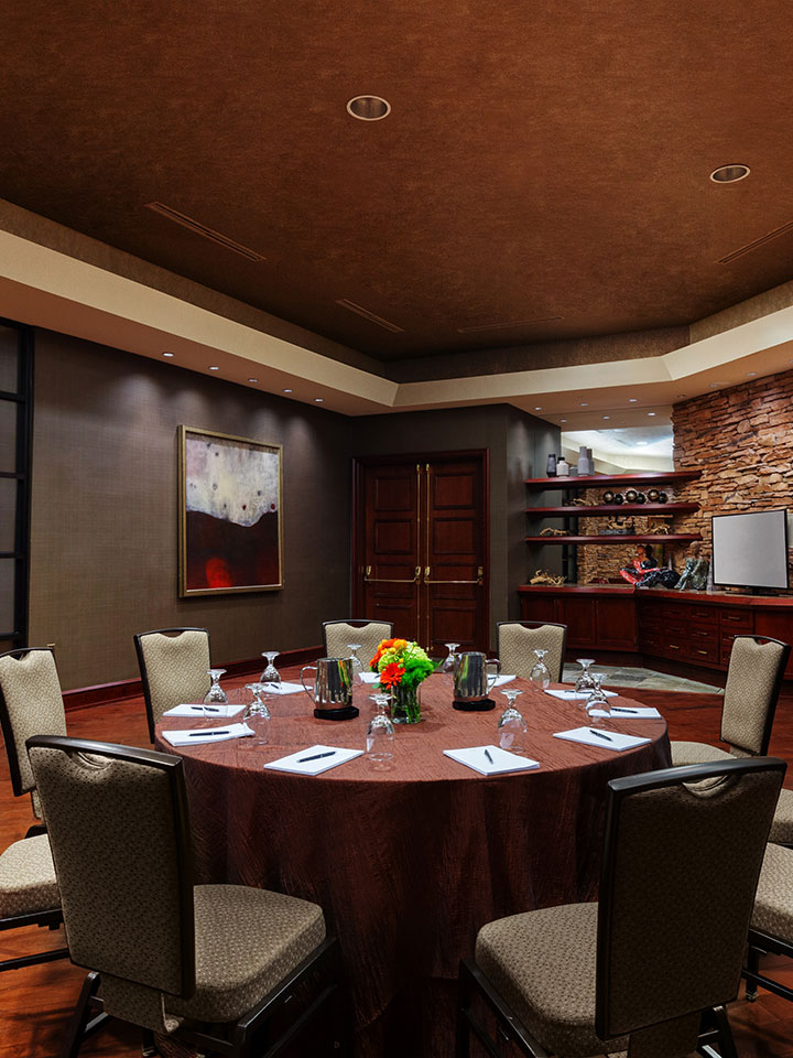 round table setting in a small room with greenish walls