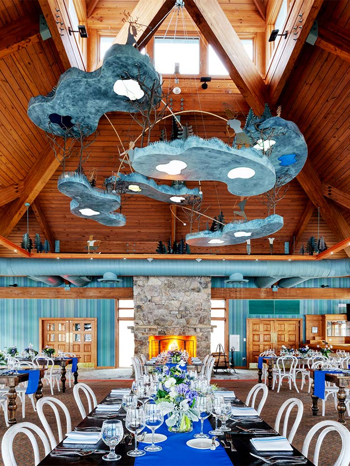 dining room with blue hanging chandelier