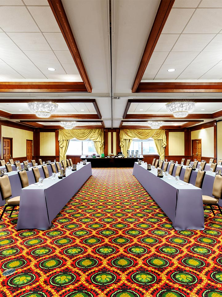 large conference style room with tables facing each other