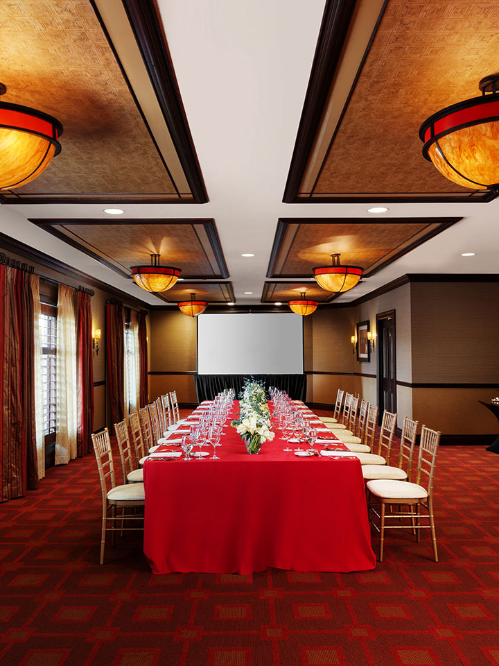 dining room with red table cloth and red carpet