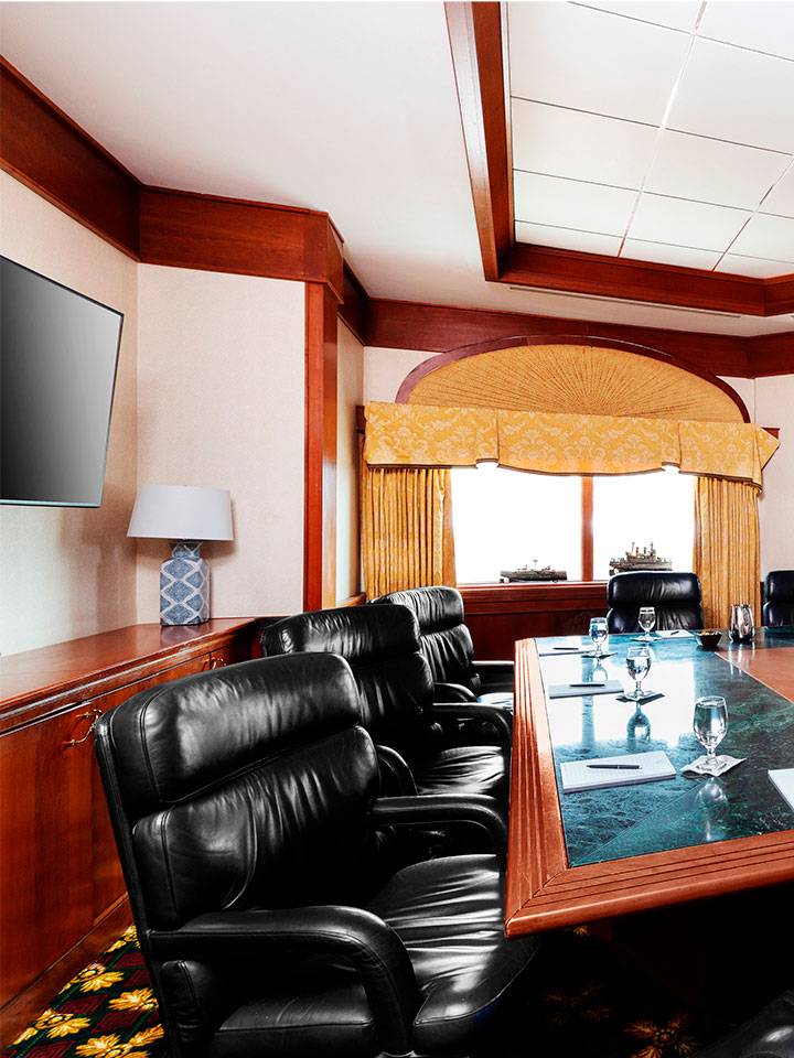 Office room with black office chairs surrounding a green marble table