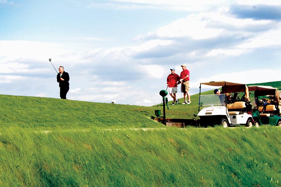 men on a golf course