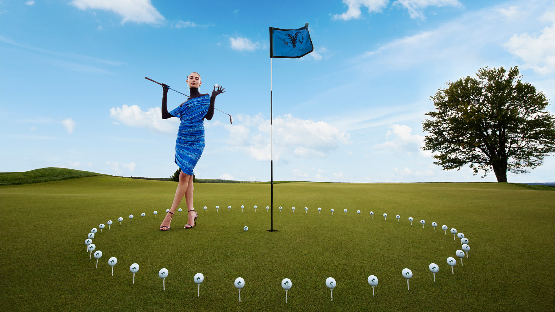 woman posing on a golf course with a flag in the middle and golf ball circle surrounding her