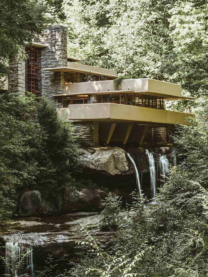 beautiful place in the woods with extended balconies and a waterfall beneath