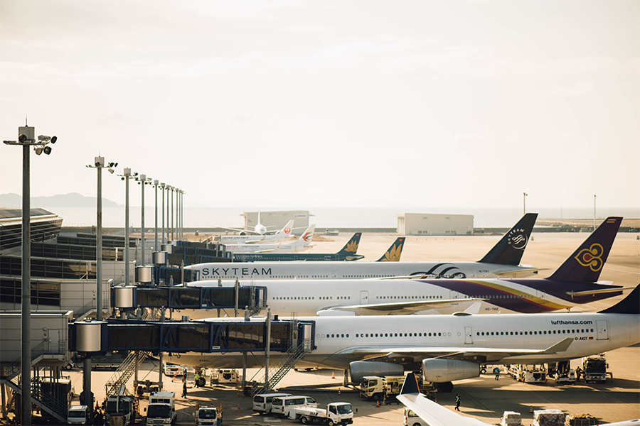 lineup of planes at an airport